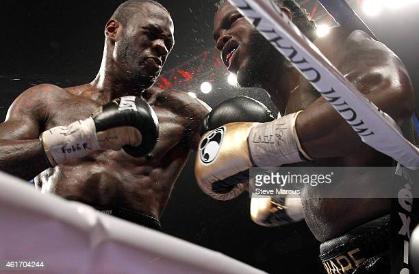 Deontay Wilder punches WBC heavyweight champion Bermane Stiverne against the ropes during their title fight at the MGM Grand Garden Arena on January...