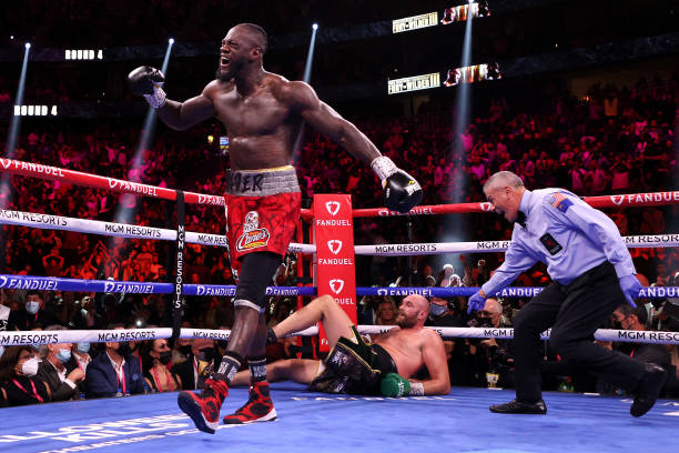 Deontay Wilder reacts after knocking down Tyson Fury in the fourth round during their WBC Heavyweight Championship title fight at T-Mobile Arena on...