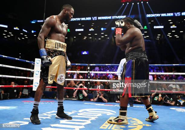 Deontay Wilder stares down Bermane Stiverne after knocking him down and the fight resumed in the first round during their rematch for Wilder's WBC...