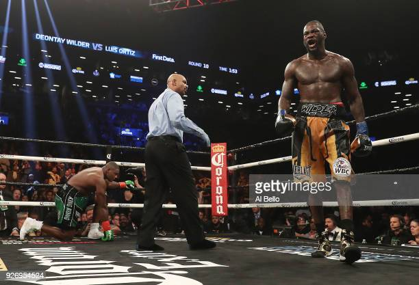 Deontay Wilder walks to a neutral corner after Luis Ortiz goes down but it was ruled a slip during their WBC Heavyweight Championship fight at...