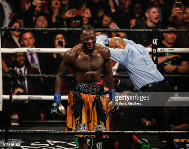 Deontay Wilder walks to a neutral corner after Luis Ortiz goes down during their WBC Heavyweight Championship fight at Barclays Center on March 3...