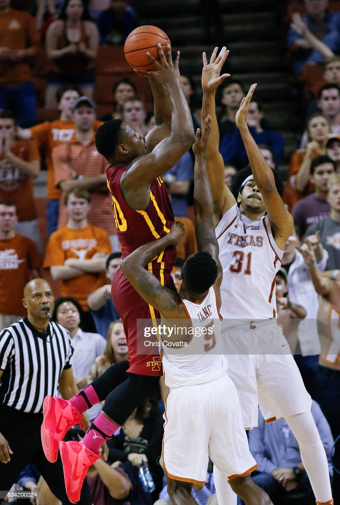 Deonte Burton #30 of the Iowa State Cyclones shoots over Jarrett Allen #31 and Kendal Yancy #5 of the Texas Longhorns at the Frank Erwin Center on February 7, 2017 in Austin, Texas.