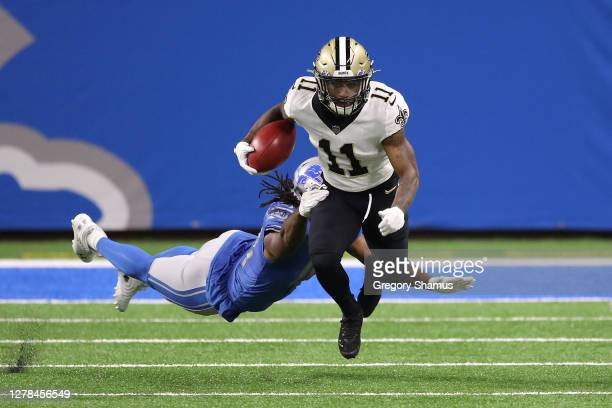 Deonte Harris of the New Orleans Saints returns a punt past Jalen Reeves-Maybin of the Detroit Lions during the first quarter at Ford Field on...