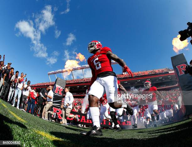 Deonte Roberts of the Rutgers Scarlet Knights leads his team onto the field for their game against the Eastern Michigan Eagles on September 9 2017 in...