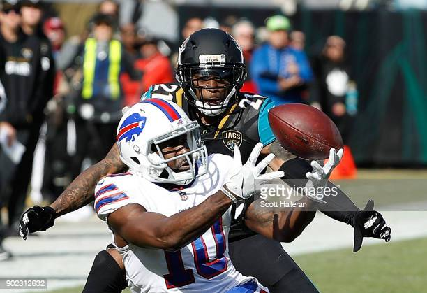 Deonte Thompson of the Buffalo Bills and AJ Bouye of the Jacksonville Jaguars battle for the football in the first half of the AFC Wild Card Round...
