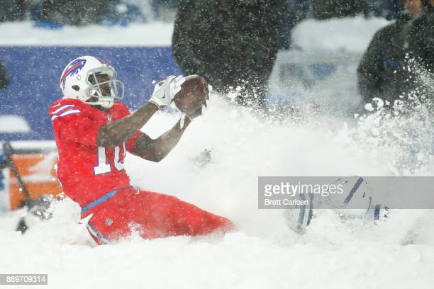 Deonte Thompson of the Buffalo Bills catches the ball as Kenny Moore of the Indianapolis Colts attempts to defend him during overtime on December 10...
