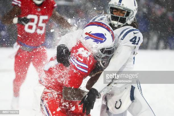 Deonte Thompson of the Buffalo Bills is tackled by Matthias Farley of the Indianapolis Colts during overtime on December 10 2017 at New Era Field in...