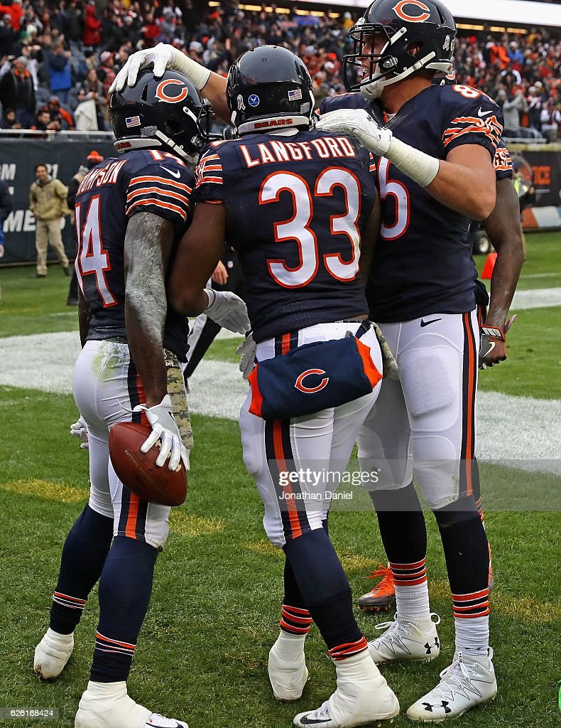 Deonte Thompson #14 of the Chicago Bears is congratulated by Jeremy Langford #33 and Daniel Brown #85 after scoring a touchdown against the Tennessee Titans at Soldier Field on November 27, 2016 in Chicago, Illinois. The Titans defeated the Bears 27-21.