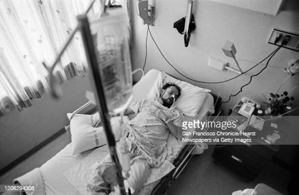 Deotis McMather who has AIDS asleep in bed at SF Generals AIDS ward 5B. After being diagnosed with AIDS, he returned to his SF apartment where all of...