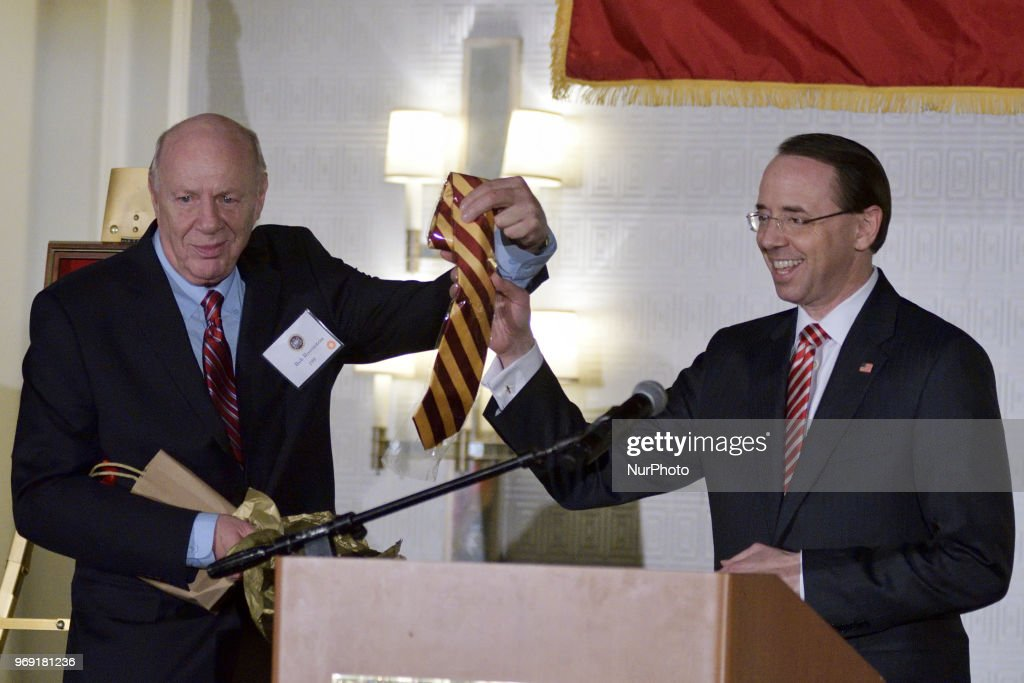 Dep. Attorney General Rod Rosenstein receives an crimson-yellow tie out of the hands of his father and Central High alumni Rob Rosenstein, during the annual alumni dinner of Central High School, in Philadelphia, PA, on June 5th, 2018.