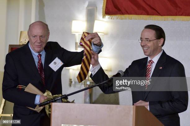 Dep Attorney General Rod Rosenstein receives an crimsonyellow tie out of the hands of his father and Central High alumni Rob Rosenstein during the...