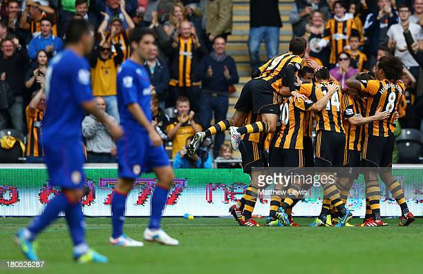 Depair for Cardiff City as Curtis Davies of Hull City celebrates with team mates as he scores their first goal during the Barclays Premier League...