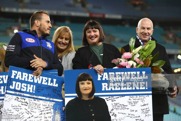 Departing Bulldogs player Josh Reynolds and CEO Raelene Castle stand on stage after a presentation to the players and officials leaving the club at...