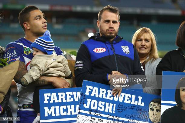 Departing Bulldogs players Michael Lichaa and Josh Reynolds pose on stage after a presentation to the players and officials leaving the club at the...