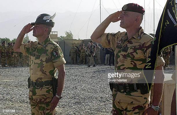 Departing Italian commander Brigadier General Giorgio Battisti and his replacement Brigadier General Marco Bertolini salute during a ceremony at...