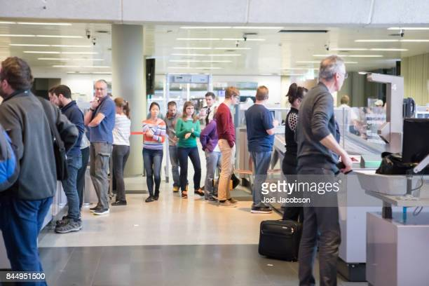 departing passengers at tsa security checkpoint at keflavik international airport, iceland - transportation security administration stock pictures, royalty-free photos & images