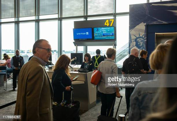 Departing passengers board a United Airlines flight at LaGuardia Airport, in the Queens borough of New York City on September 8, 2019. LaGuardia's...