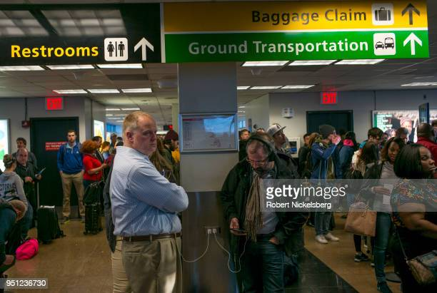Departing passengers wait to board a Southwest Airlines plane April 20 2018 at LaGuardia Airport in New York City Southwest Airlines is headquartered...