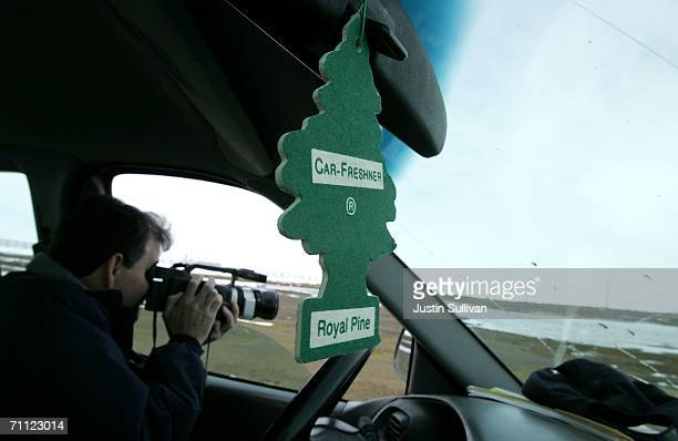 S Department of Agriculture Wildlife Biologist Corey Rossi uses a video camera to document migratory birds near a landfill June 4 2006 in Browerville...