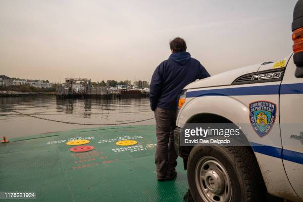 Department of Correction worker looks on at the ferry which the is the only accessible route to Hart Island on October 25 2019 in New York City Hart...