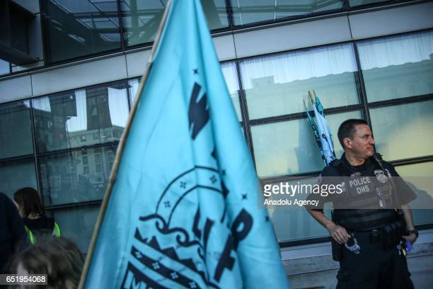 Department of Homeland Security officer stands outside the Federal Building during a protest in solidarity with the Standing Rock Sioux Tribe in San...