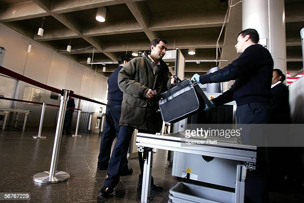 S Department of Homeland Security official assists commuters passing through weapondetection equipment at Exchange Place station on the first day of...