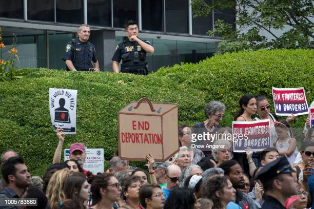 Department of Homeland Security Police officers members of the Federal Protective Service observe as activists rally against the Trump...