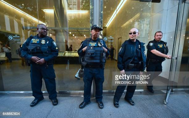 Department of Homeland Security police officers stand guard in front of the Los Angeles Immigration Court building where protesters gathered...
