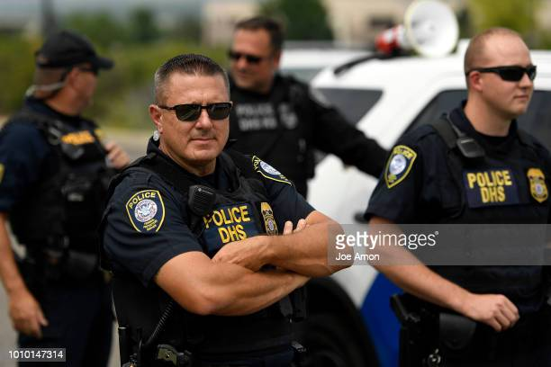 Department of Homeland Security Police watch patiently as Abolish ICE Denver protesters blocked the exits and entrances of the US Immigration and...
