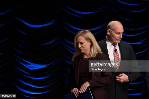 Department of Homeland Security Secretary Kirstjen Nielsen and White House Chief of Staff John Kelly exit the stage after speaking during an event to...