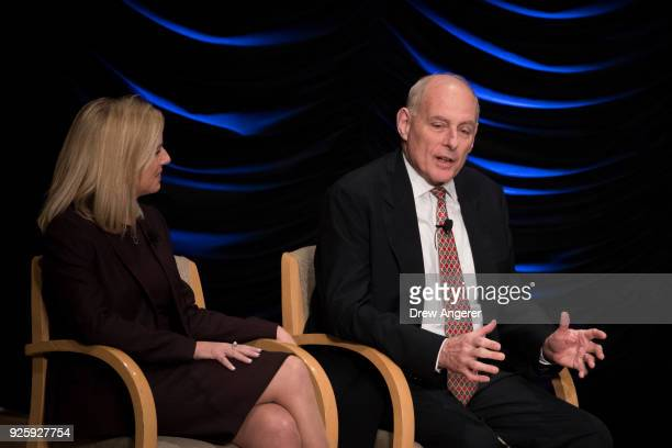 Department of Homeland Security Secretary Kirstjen Nielsen looks on as White House Chief of Staff John Kelly speaks during an event to mark the 15th...