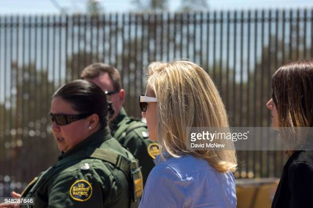 S Department of Homeland Security Secretary Kirstjen Nielsen passes a new section of fence as she tours a replacement border fence construction site...