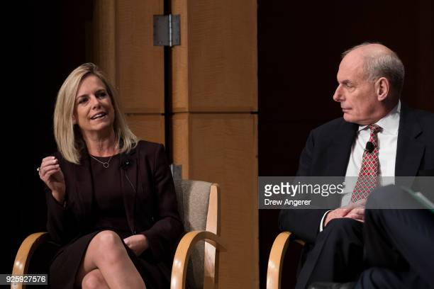 Department of Homeland Security Secretary Kirstjen Nielsen speaks as White House Chief of Staff John Kelly looks on during an event to mark the 15th...
