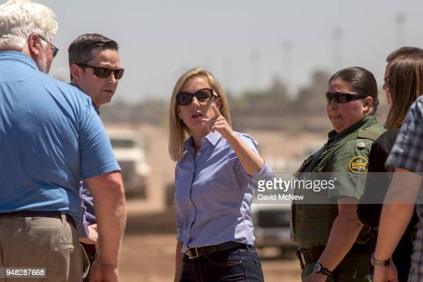 S Department of Homeland Security Secretary Kirstjen Nielsen tours a replacement border wall construction site on April 18 2018 in Calexico...