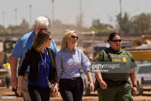 S Department of Homeland Security Secretary Kirstjen Nielsen tours a replacement border fence construction site on April 18 2018 in Calexico...