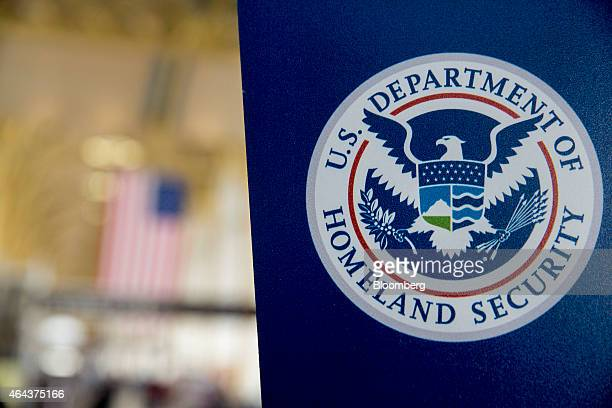 A US Department of Homeland Security sign stands at Ronald Reagan National Airport in Washington DC US on Wednesday Feb 25 2015 Financing for the DHS...