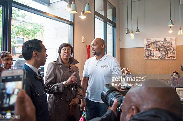 S Department of Housing and Urban Development Secretary Julian Castro and Washington DC Mayor Muriel Bowser talk with Donnie Simpson Jr owner of...