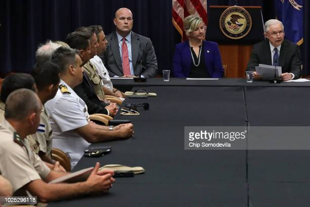 Department of Justice Chief of Staff Matt Whitaker the FBI's Kristi Johnson and US Attorney General Jeff Sessions participate in a round table event...