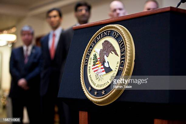 Department of Justice seal is displayed on a podium during a news conference to announce money laundering charges against HSBC on December 11 2012 in...