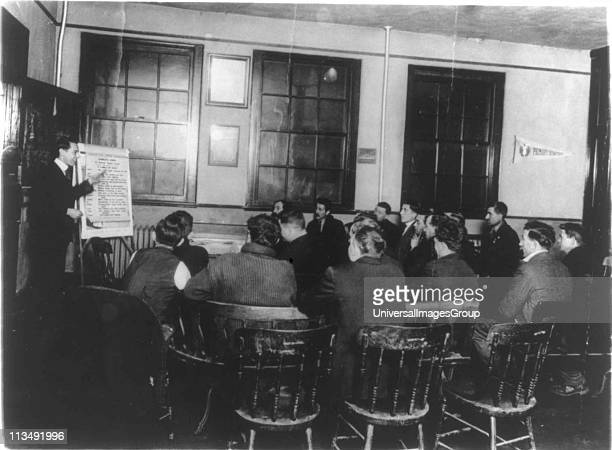 Department of Labor training service Italian immigrants receiving instruction in English and citizenship YMCA Newark NJ USA Photograph c1920c1930