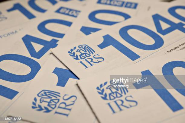 US Department of the Treasury Internal Revenue Service 1040 Individual Income Tax form packets for the 2018 tax year are arranged for a photograph in...