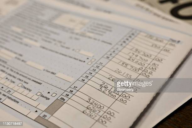 A US Department of the Treasury Internal Revenue Service 1040 Individual Income Tax form for the 2018 tax year is arranged for a photograph in...