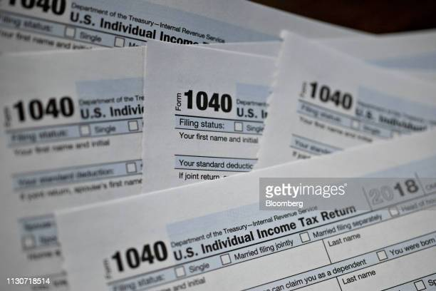 US Department of the Treasury Internal Revenue Service 1040 Individual Income Tax forms for the 2018 tax year are arranged for a photograph in...