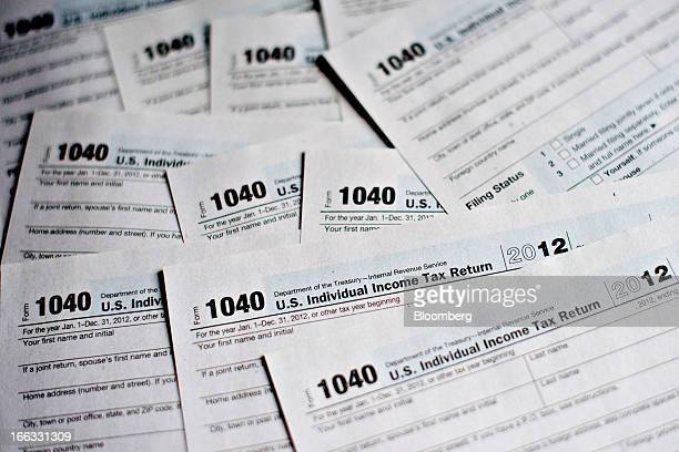 US Department of the Treasury Internal Revenue Service 1040 Individual Income Tax forms for the 2012 tax year are arranged for a photograph in...