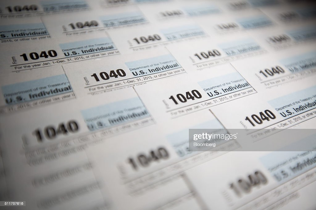 U.S. Department of the Treasury Internal Revenue Service (IRS) 1040 Individual Income Tax forms for the 2015 tax year are seen in this arranged photograph taken in New York, U.S., on Wednesday, Feb. 17, 2016. The IRS began accepting 2015 individual income tax returns today and taxpayers have until Monday, April 18 to file their 2015 tax returns and pay any tax. Photographer: Michael Nagle/Bloomberg via Getty Images