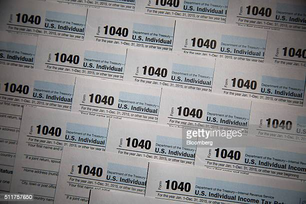US Department of the Treasury Internal Revenue Service 1040 Individual Income Tax forms for the 2015 tax year are seen in this arranged photograph...