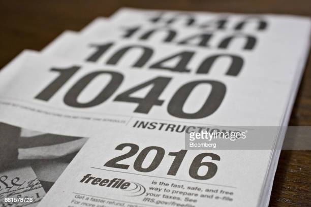 US Department of the Treasury Internal Revenue Service 1040 Individual Income Tax instruction books for the 2016 tax year are arranged for a...