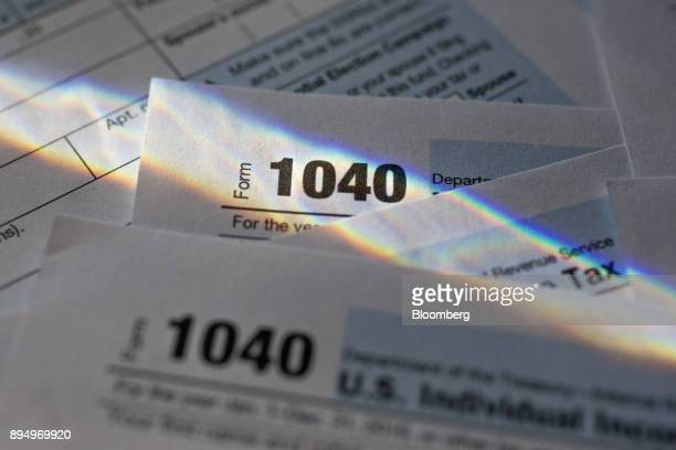 US Department of the Treasury Internal Revenue Service 1040 Individual Income Tax forms for the 2016 tax year are arranged for a photograph in...