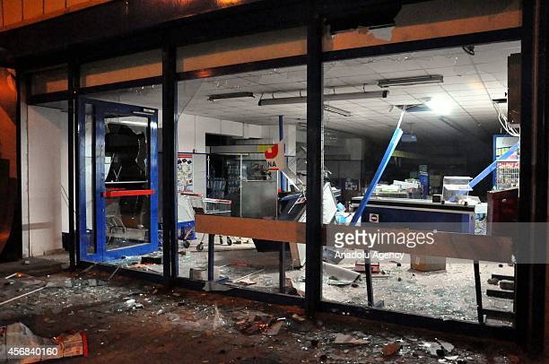 A department store is damaged and plundered by protestors during the unauthorized protests taken place in Mus against the advance of Islamic State of...