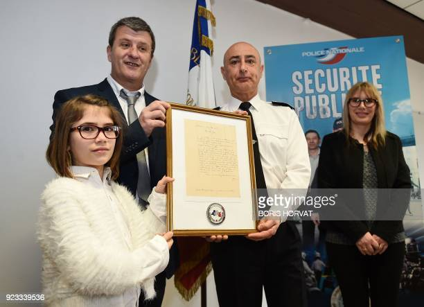 Departmental director of public security of Bouches du Rhone JeanMarie Salanova hands over a reproduction of a letter of World War I soldier Jean...